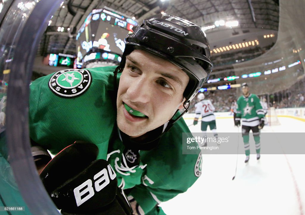 Jamie Benn of the Dallas Stars reacts after being checked into the boards by the Minnesota Wild in the first period in Game Two of the Western...