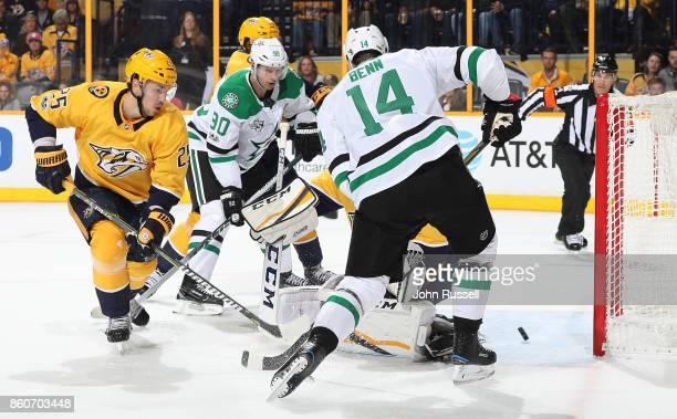 Jamie Benn of the Dallas Stars scores against Alexei Emelin and Pekka Rinne of the Nashville Predators during an NHL game at Bridgestone Arena on...