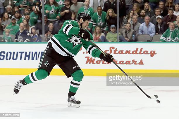 Jamie Benn of the Dallas Stars shoots the puck against the St Louis Blues in the first period at American Airlines Center on March 12 2016 in Dallas...