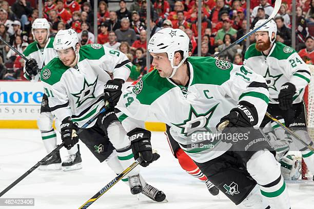 Jamie Benn of the Dallas Stars skates as Tyler Seguin and Jordie Benn skate behind during the NHL game against the Chicago Blackhawks at the United...