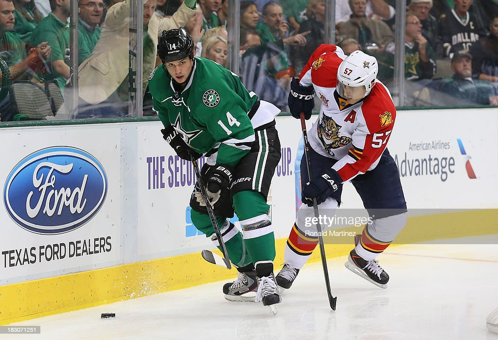 <a gi-track='captionPersonalityLinkClicked' href=/galleries/search?phrase=Jamie+Benn&family=editorial&specificpeople=4595070 ng-click='$event.stopPropagation()'>Jamie Benn</a> #14 of the Dallas Stars skates the puck against <a gi-track='captionPersonalityLinkClicked' href=/galleries/search?phrase=Marcel+Goc&family=editorial&specificpeople=541626 ng-click='$event.stopPropagation()'>Marcel Goc</a> #57 of the Florida Panthers at American Airlines Center on October 3, 2013 in Dallas, Texas.