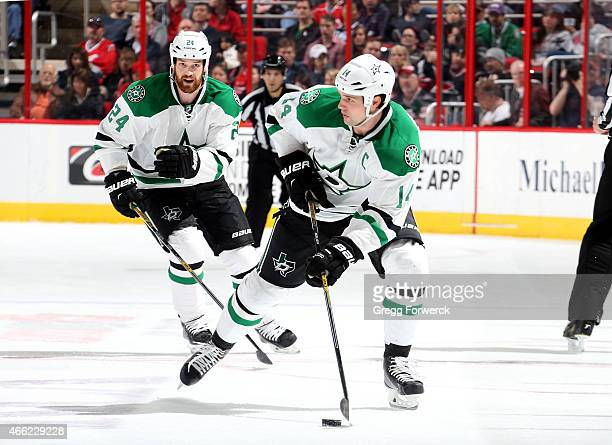 Jamie Benn of the Dallas Stars skates with the puck ahead of teammate and brother Jordie Benn during their NHL game at PNC Arena on March 12 2015 in...
