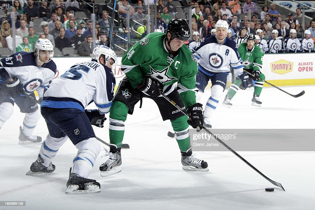 <a gi-track='captionPersonalityLinkClicked' href=/galleries/search?phrase=Jamie+Benn&family=editorial&specificpeople=4595070 ng-click='$event.stopPropagation()'>Jamie Benn</a> #14 of the Dallas Stars spins and looks to get off a shot against <a gi-track='captionPersonalityLinkClicked' href=/galleries/search?phrase=Matt+Halischuk&family=editorial&specificpeople=714406 ng-click='$event.stopPropagation()'>Matt Halischuk</a> #15 of the Winnipeg Jets at the American Airlines Center on October 26, 2013 in Dallas, Texas.