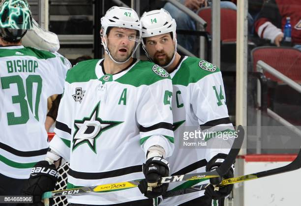 Jamie Benn of the Dallas Stars talks with teammate Alexander Radulov during a stop in play against the Arizona Coyotes at Gila River Arena on October...