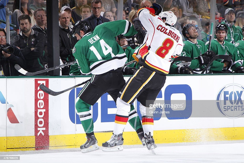 <a gi-track='captionPersonalityLinkClicked' href=/galleries/search?phrase=Jamie+Benn&family=editorial&specificpeople=4595070 ng-click='$event.stopPropagation()'>Jamie Benn</a> #14 of the Dallas Stars tries to keep the puck away against <a gi-track='captionPersonalityLinkClicked' href=/galleries/search?phrase=Joe+Colborne&family=editorial&specificpeople=5370968 ng-click='$event.stopPropagation()'>Joe Colborne</a> #8 of the Calgary Flames at the American Airlines Center on March 14, 2014 in Dallas, Texas.