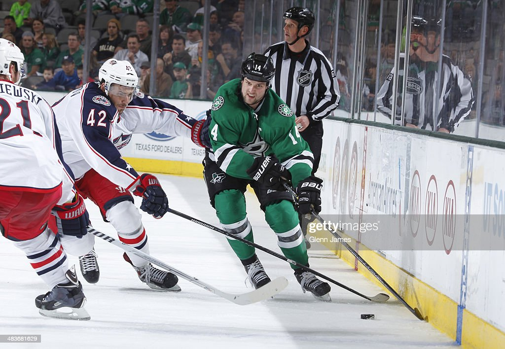 Jamie Benn #14 of the Dallas Stars tries to keep the puck away against Artem Anisimov #42 of the Columbus Blue Jackets at the American Airlines Center on April 9, 2014 in Dallas, Texas.