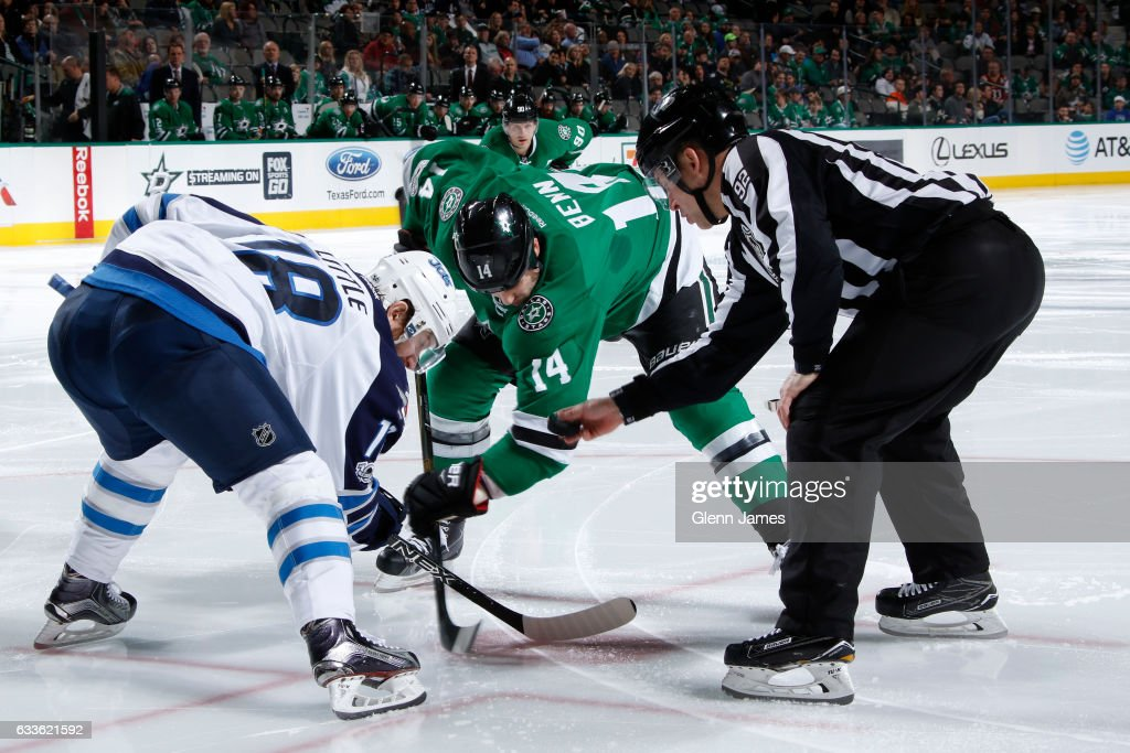Jamie Benn #14 of the Dallas Stars tries to win a face off against Bryan Little #18 of the Winnipeg Jets at the American Airlines Center on February 2, 2017 in Dallas, Texas.