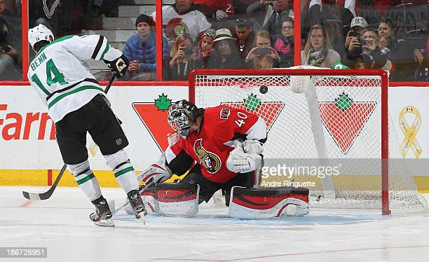 Jamie Benn the Dallas Stars scores the shootout winner against Robin Lehner of the Ottawa Senators at Canadian Tire Centre on November 3 2013 in...