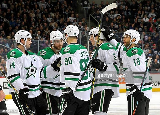 Jamie Benn Tyler Seguin Jason Spezza John Klingberg and Patrick Eaves of the Dallas Stars celebrate a third period goal against the Winnipeg Jets on...