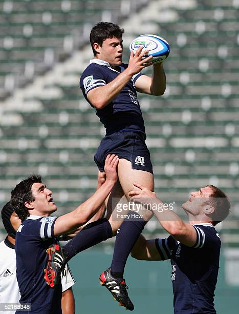 Jamie Blackwood of Scotland catches a throwin with the assist of team mates Kelly Brown and Alasdair Strokosch against New Zealand during the 2005...
