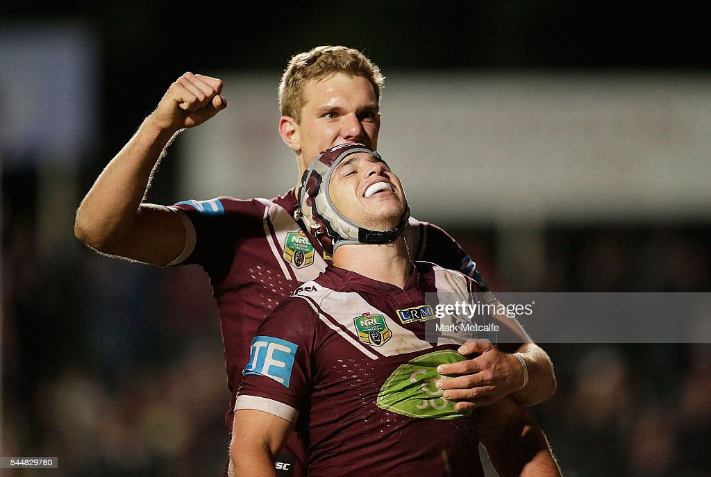 Jamie Buhrer of the Sea Eagles celebrates scoring a try with team mate Tom Trbojevic during the round 17 NRL match between the Manly Sea Eagles and the St George Illawarra Dragons at Brookvale Oval on July 4, 2016 in Sydney, Australia.