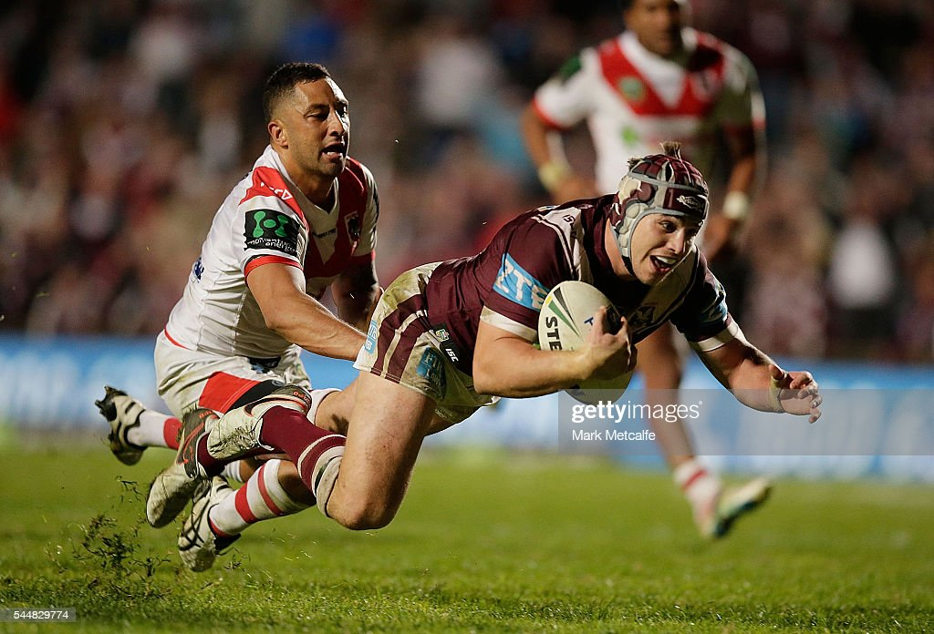 Jamie Buhrer of the Sea Eagles evades the tackle of Benji Marshall of the Dragons to score a try during the round 17 NRL match between the Manly Sea Eagles and the St George Illawarra Dragons at Brookvale Oval on July 4, 2016 in Sydney, Australia.