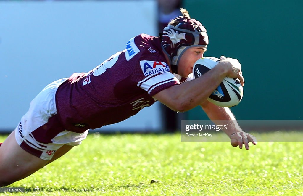 Jamie Buhrer of the Sea Eagles scores a try during the round 25 NRL match between the Manly Sea Eagles and the Penrith Panthers at Brookvale Oval on...