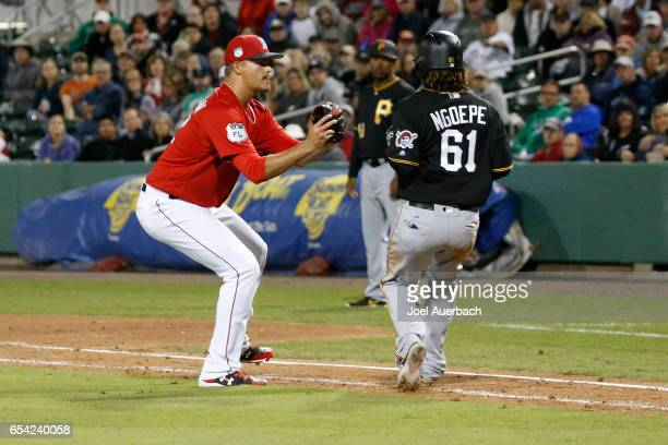 Jamie Callahan of the Boston Red Sox tags out Gift Ngoepe of the Pittsburgh Pirates for the final out in the ninth inning during a spring training...