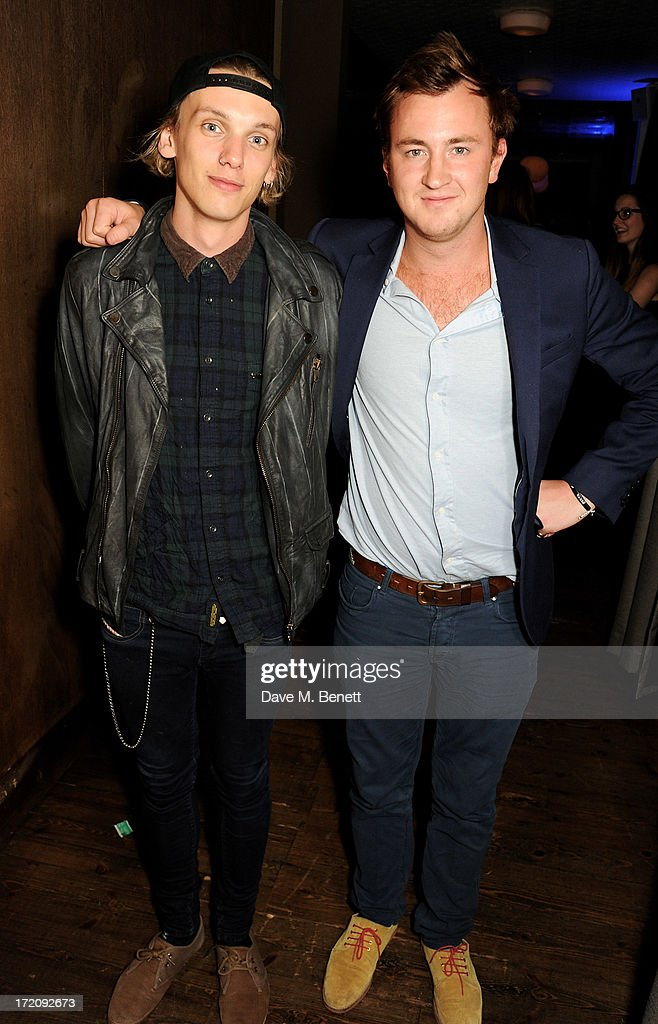 Jamie Campbell Bower (L) and Francis Boulle attend an after party following 'A Curious Night at the Theatre', a charity gala evening to raise funds for Ambitious about Autism and The National Autistic Society, at Century Club on July 1, 2013 in London, England.