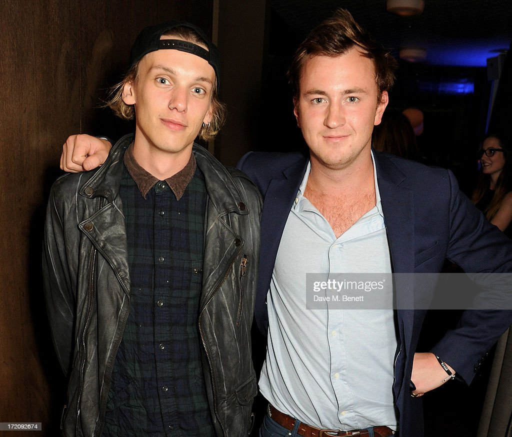 <a gi-track='captionPersonalityLinkClicked' href=/galleries/search?phrase=Jamie+Campbell+Bower&family=editorial&specificpeople=4586724 ng-click='$event.stopPropagation()'>Jamie Campbell Bower</a> (L) and Francis Boulle attend an after party following 'A Curious Night at the Theatre', a charity gala evening to raise funds for Ambitious about Autism and The National Autistic Society, at Century Club on July 1, 2013 in London, England.