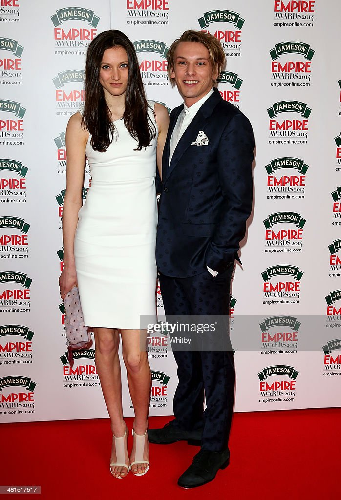 Jamie Campbell Bower and guest attend the Jameson Empire Awards 2014 at the Grosvenor House Hotel on March 30, 2014 in London, England. Regarded as a relaxed end to the awards show season, the Jameson Empire Awards celebrate the film industry's success stories of the year with winners being voted for entirely by members of the public. Visit empireonline.com/awards2014 for more information.