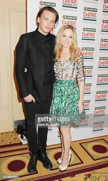 Jamie Campbell Bower and Joanne Froggatt pose in the press room at the Jameson Empire Awards at Grosvenor House on March 25 2012 in London England