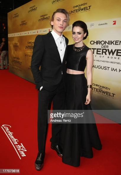 Jamie Campbell Bower and Lily Collins arrives for the 'The Mortal Instruments City of Bones' Germany premiere at Sony Centre on August 20 2013 in...