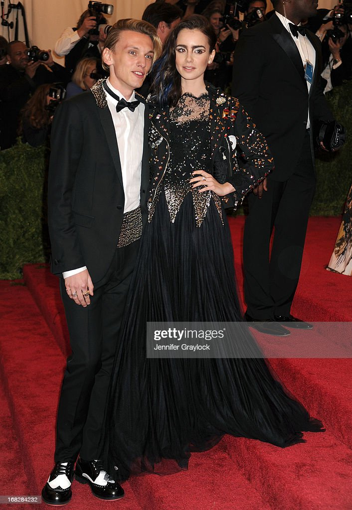 Jamie Campbell Bower and Lily Collins attend the Costume Institute Gala for the 'PUNK: Chaos to Couture' exhibition at the Metropolitan Museum of Art on May 6, 2013 in New York City.
