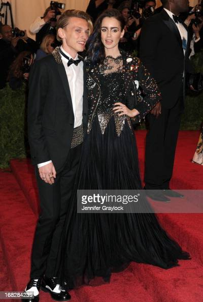 Jamie Campbell Bower and Lily Collins attend the Costume Institute Gala for the 'PUNK Chaos to Couture' exhibition at the Metropolitan Museum of Art...