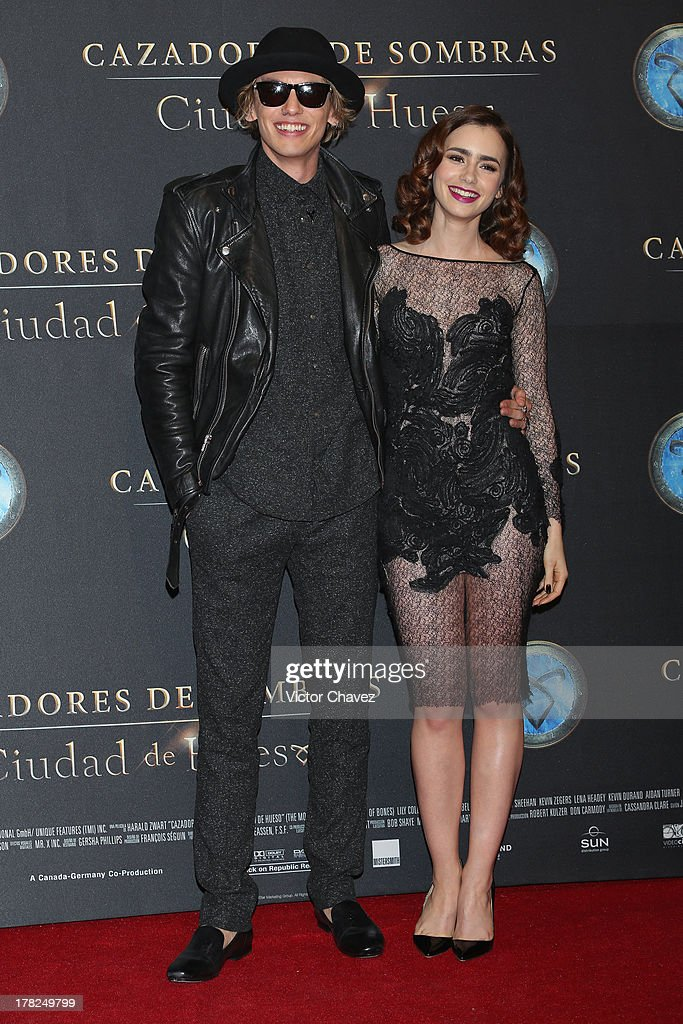 Jamie Campbell Bower and Lily Collins attend The Mortal Instruments: City of Bones' Mexico City screening at Auditorio Nacional on August 27, 2013 in Mexico City, Mexico.