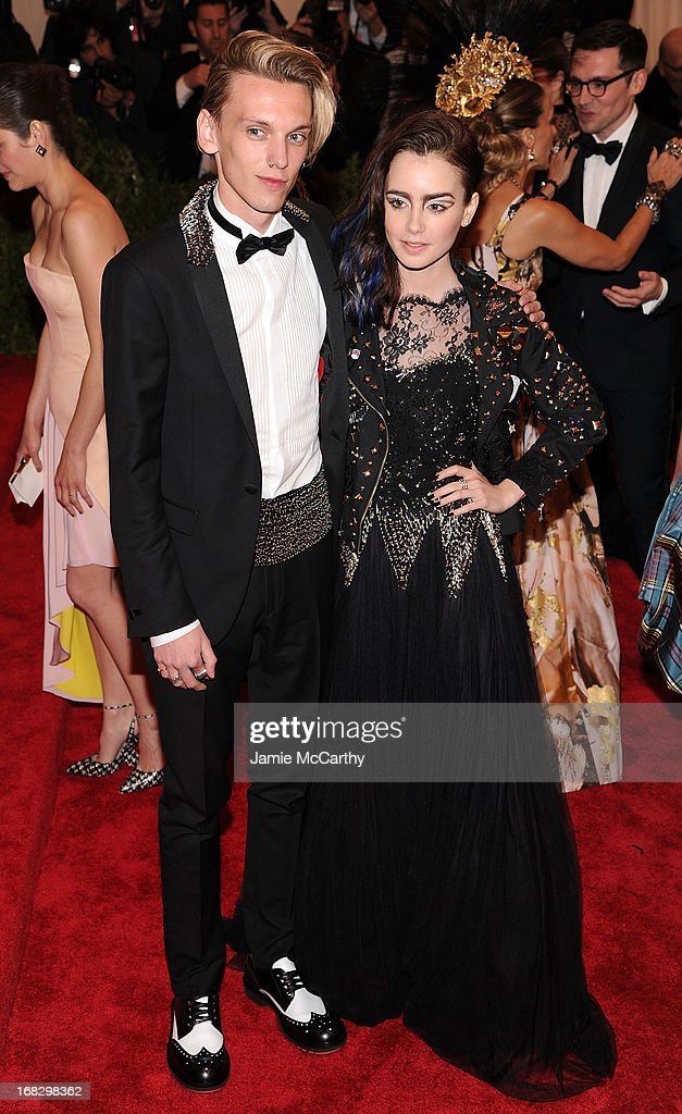 Jamie Campbell Bower and Lily Collins attends the Costume Institute Gala for the 'PUNK: Chaos to Couture' exhibition at the Metropolitan Museum of Art on May 6, 2013 in New York City.
