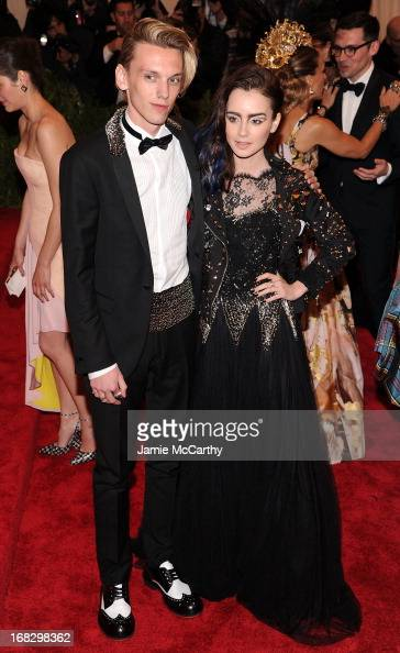 Jamie Campbell Bower and Lily Collins attends the Costume Institute Gala for the 'PUNK Chaos to Couture' exhibition at the Metropolitan Museum of Art...