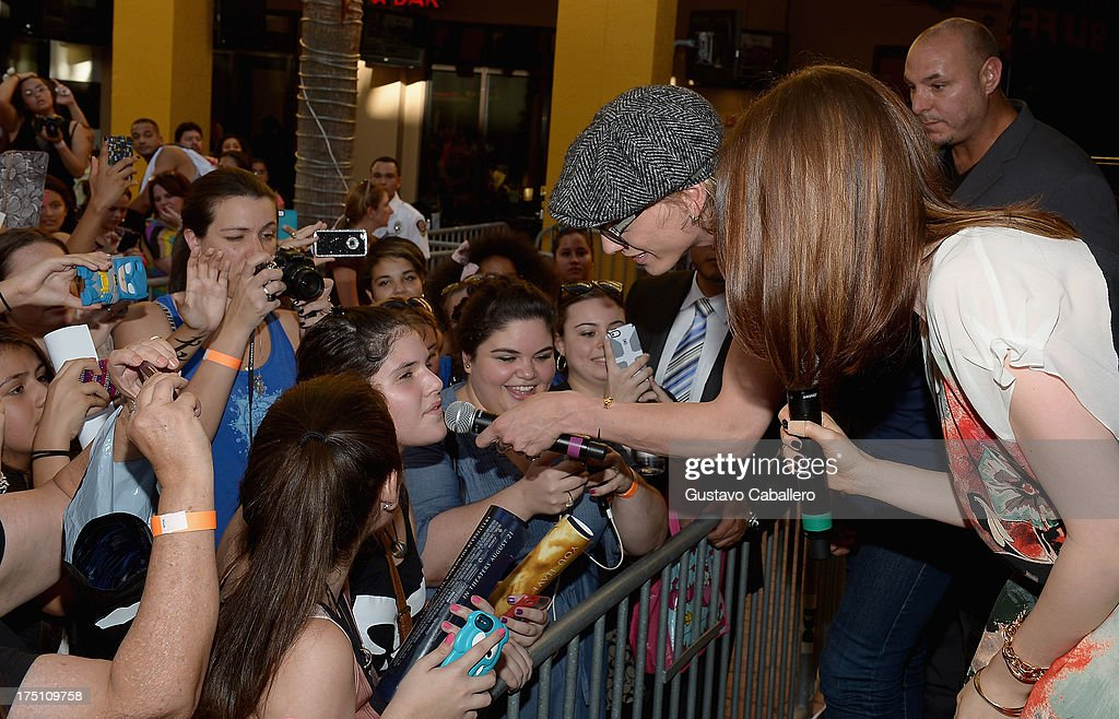 <a gi-track='captionPersonalityLinkClicked' href=/galleries/search?phrase=Jamie+Campbell+Bower&family=editorial&specificpeople=4586724 ng-click='$event.stopPropagation()'>Jamie Campbell Bower</a> and <a gi-track='captionPersonalityLinkClicked' href=/galleries/search?phrase=Lily+Collins&family=editorial&specificpeople=3520243 ng-click='$event.stopPropagation()'>Lily Collins</a> of 'The Mortal Instruments' at Dolphin Mall on July 31, 2013 in Miami, Florida.