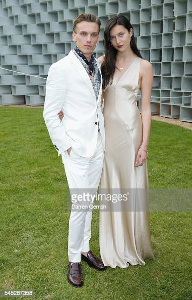 Jamie Campbell Bower and Matilda Lowther attend the Serpentine Summer Party cohosted by Tommy Hilfiger at the Serpentine Gallery on July 6 2016 in...