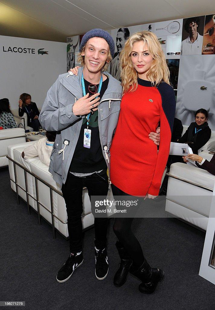 Jamie Campbell Bower (L) and Tamsin Egerton attends the Lacoste VIP lounge during day eight of the ATP World Finals at the O2 Arena on November 12, 2012 in London, England.