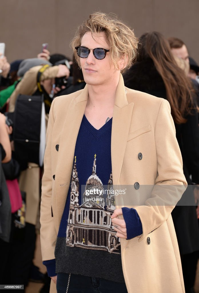 Jamie Campbell Bower arrives at Burberry Womenswear Autumn/Winter 2014 at Kensington Gardens on February 17, 2014 in London, England.