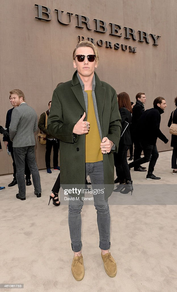 Jamie Campbell Bower arrives at the Burberry AW14 Menswear Show at Kensington Gardens on January 8, 2014 in London, England.