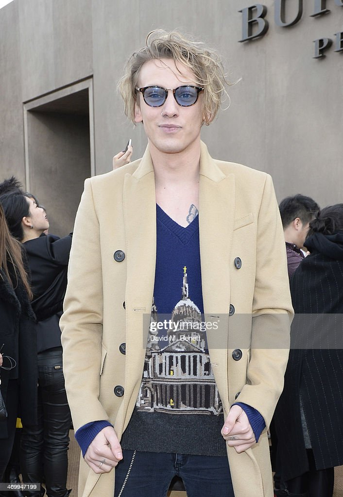 Jamie Campbell Bower attends the front row at Burberry Womenswear Autumn/Winter 2014 at Kensington Gardens on February 17, 2014 in London, England.