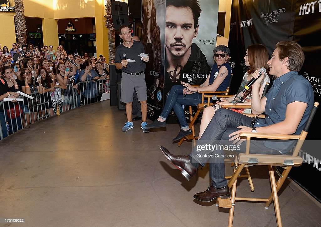 Jamie Campbell Bower, Lily Collins and Kevin Zegers of 'The Mortal Instruments' at Dolphin Mall on July 31, 2013 in Miami, Florida.