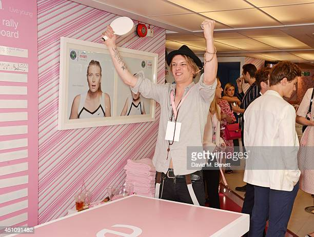 Jamie Campbell Bower plays table tennis in the evian Live Young suite on the opening day of Wimbledon at the All England Lawn Tennis and Croquet Club...