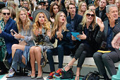 Jamie Campbell Bower Poppy Delevingne Paloma Faith Cara Delevingne Kate Moss and Mario Testino attend the front row at the Burberry Womenswear SS15...