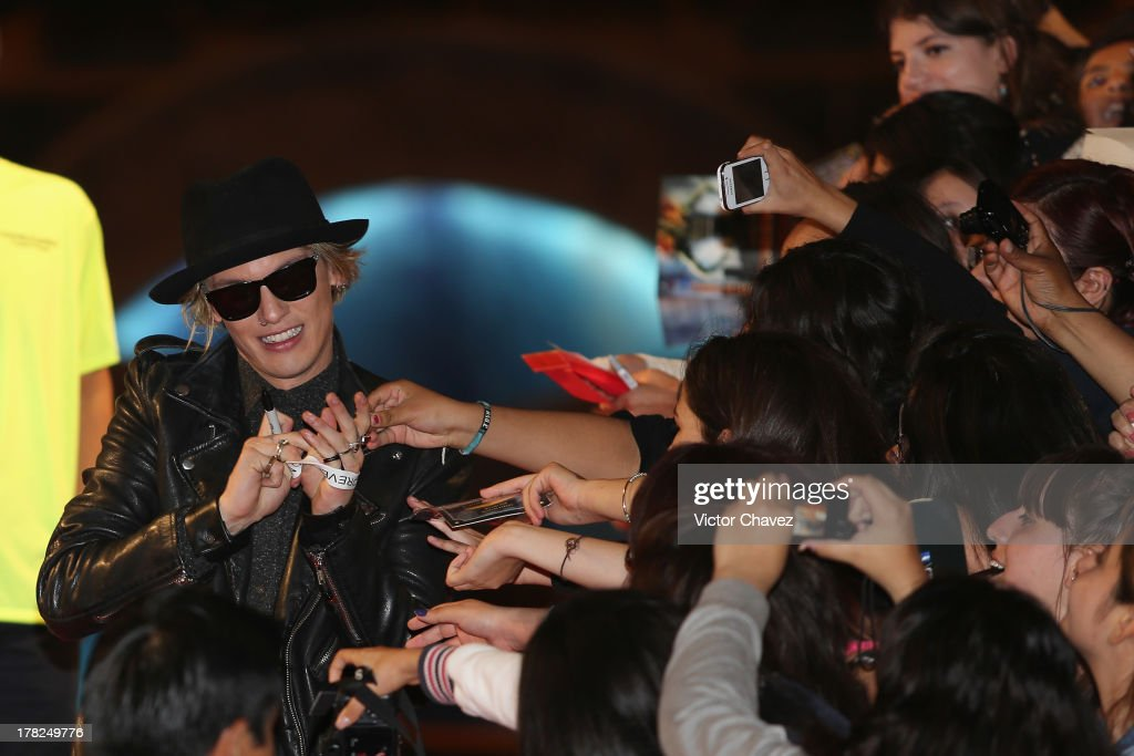 <a gi-track='captionPersonalityLinkClicked' href=/galleries/search?phrase=Jamie+Campbell+Bower&family=editorial&specificpeople=4586724 ng-click='$event.stopPropagation()'>Jamie Campbell Bower</a> signs autographs to fans during The Mortal Instruments: City of Bones' Mexico City screening at Auditorio Nacional on August 27, 2013 in Mexico City, Mexico.