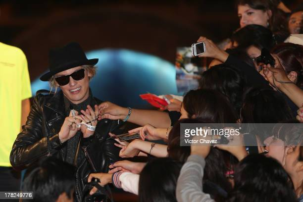 Jamie Campbell Bower signs autographs to fans during The Mortal Instruments City of Bones' Mexico City screening at Auditorio Nacional on August 27...