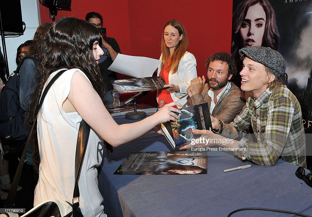 Jamie Campbell Bower signs autographs to fans of 'Shadow Hunters' on June 27, 2013 in Barcelona, Spain.