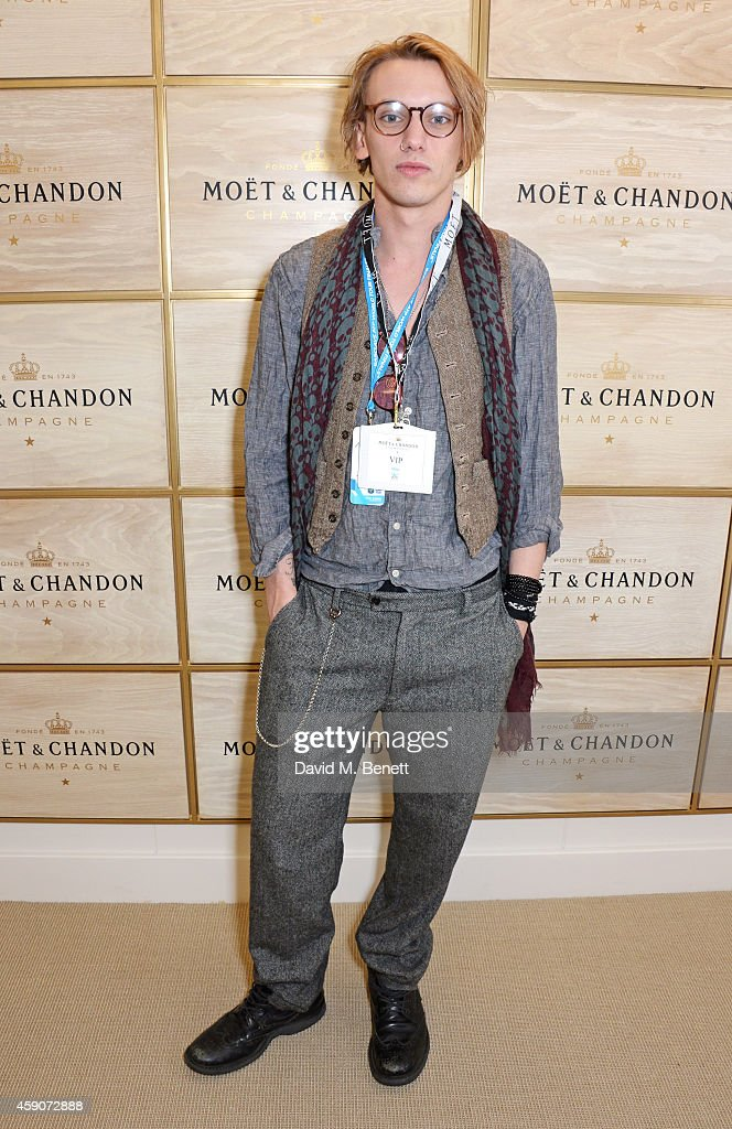 <a gi-track='captionPersonalityLinkClicked' href=/galleries/search?phrase=Jamie+Campbell+Bower&family=editorial&specificpeople=4586724 ng-click='$event.stopPropagation()'>Jamie Campbell Bower</a> toasts with Moet & Chandon, the champagne of celebration and tennis, to the winner of the 2014 Barclays ATP World Tour Finals, at the O2 Arena on November 16, 2014 in London, England.