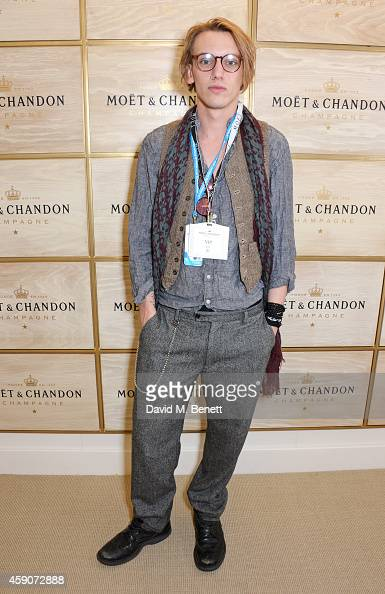 Jamie Campbell Bower toasts with Moet Chandon the champagne of celebration and tennis to the winner of the 2014 Barclays ATP World Tour Finals at the...