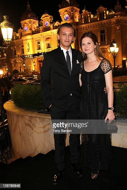 Jamie CampbellBower and Bonnie Wright attend Roger Dubuis Soiree Monegasque at Hotel de Paris on October 20 2011 in Monaco Monaco