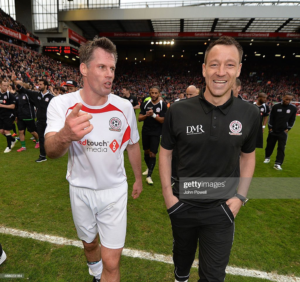 Jamie Carragher and John Terry at the end of the Liverpool All Star Charity Match at Anfield on March 29, 2015 in Liverpool, England.