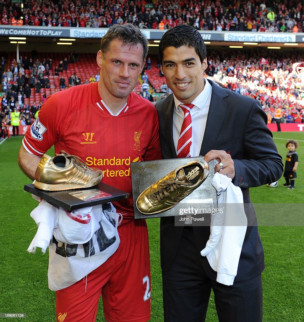 <a gi-track='captionPersonalityLinkClicked' href=/galleries/search?phrase=Jamie+Carragher&family=editorial&specificpeople=206485 ng-click='$event.stopPropagation()'>Jamie Carragher</a> and Luis Suarez of Liverpool pose at the end of the Barclays Premier League match between Liverpool and Queens Park Rangers at Anfield on May 19, 2013 in Liverpool England.