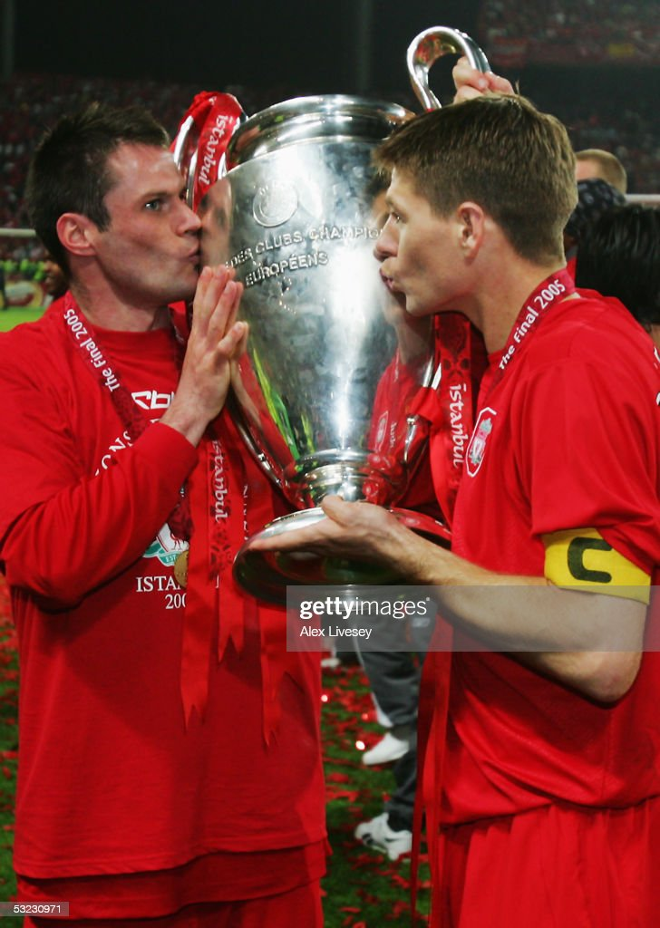 Jamie Carragher and Steven Gerrard of Liverpool kiss the trophy following victory in the European Champions League final between Liverpool and AC Milan on May 25, 2005 at the Ataturk Olympic Stadium in Istanbul, Turkey.