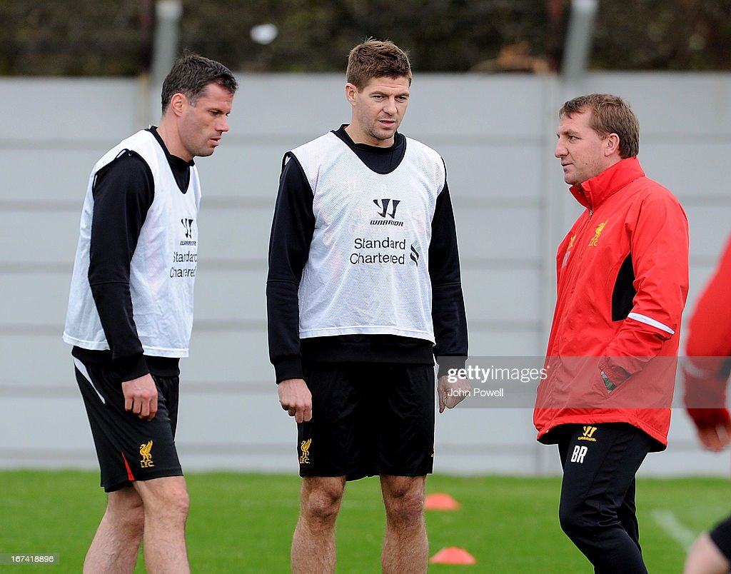 Jamie Carragher and Steven Gerrard talks with the manager of Liverpool Brendan Rodgers during a training session at Melwood Training Ground on April 25, 2013 in Liverpool, England.