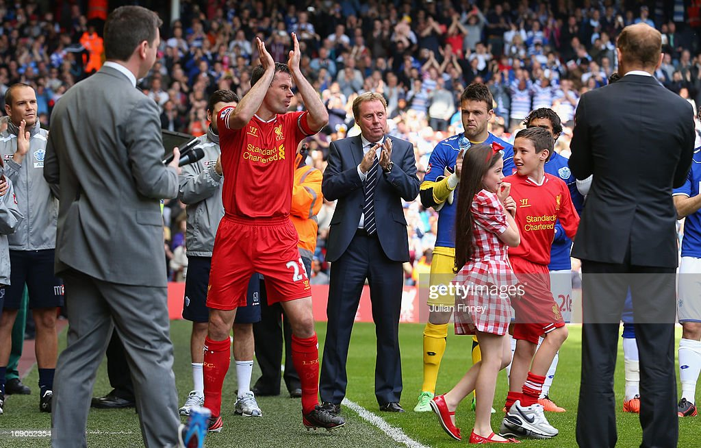 <a gi-track='captionPersonalityLinkClicked' href=/galleries/search?phrase=Jamie+Carragher&family=editorial&specificpeople=206485 ng-click='$event.stopPropagation()'>Jamie Carragher</a> of Liverpool applauds the fans as he walks out with his childen for his final match prior to the Barclays Premier League match between Liverpool and Queens Park Rangers at Anfield on May 19, 2013 in Liverpool, England.