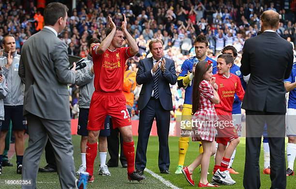 Jamie Carragher of Liverpool applauds the fans as he walks out with his childen for his final match prior to the Barclays Premier League match...
