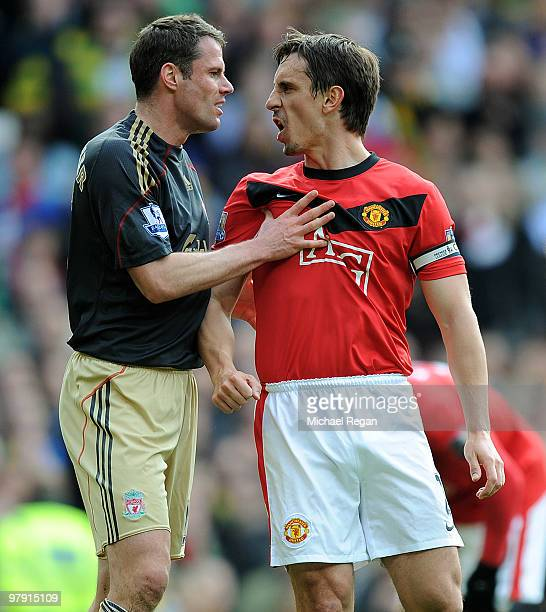 Jamie Carragher of Liverpool argues with Gary Neville of Manchester United after United were awarded a penalty in the first half of the Barclays...